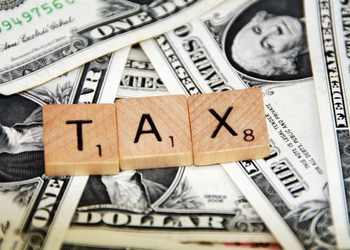 impuestos tasas dólares